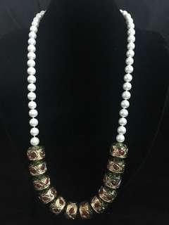 Pearl necklace with indian beads
