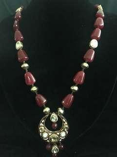 Beautiful necklace with ruby beads and polki stones