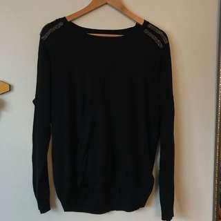 Black long sleeve top with gold shoulder