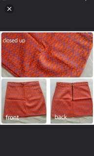 Short skirt in orange