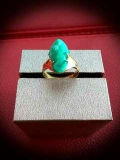 Jade in 916 gold ring.