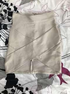 Fitted nude mini skirt