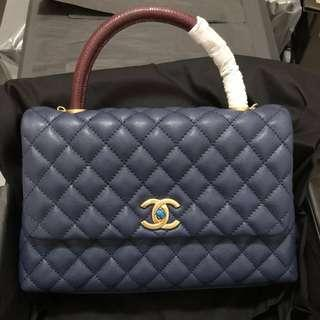 Chanel coco with lizard handle