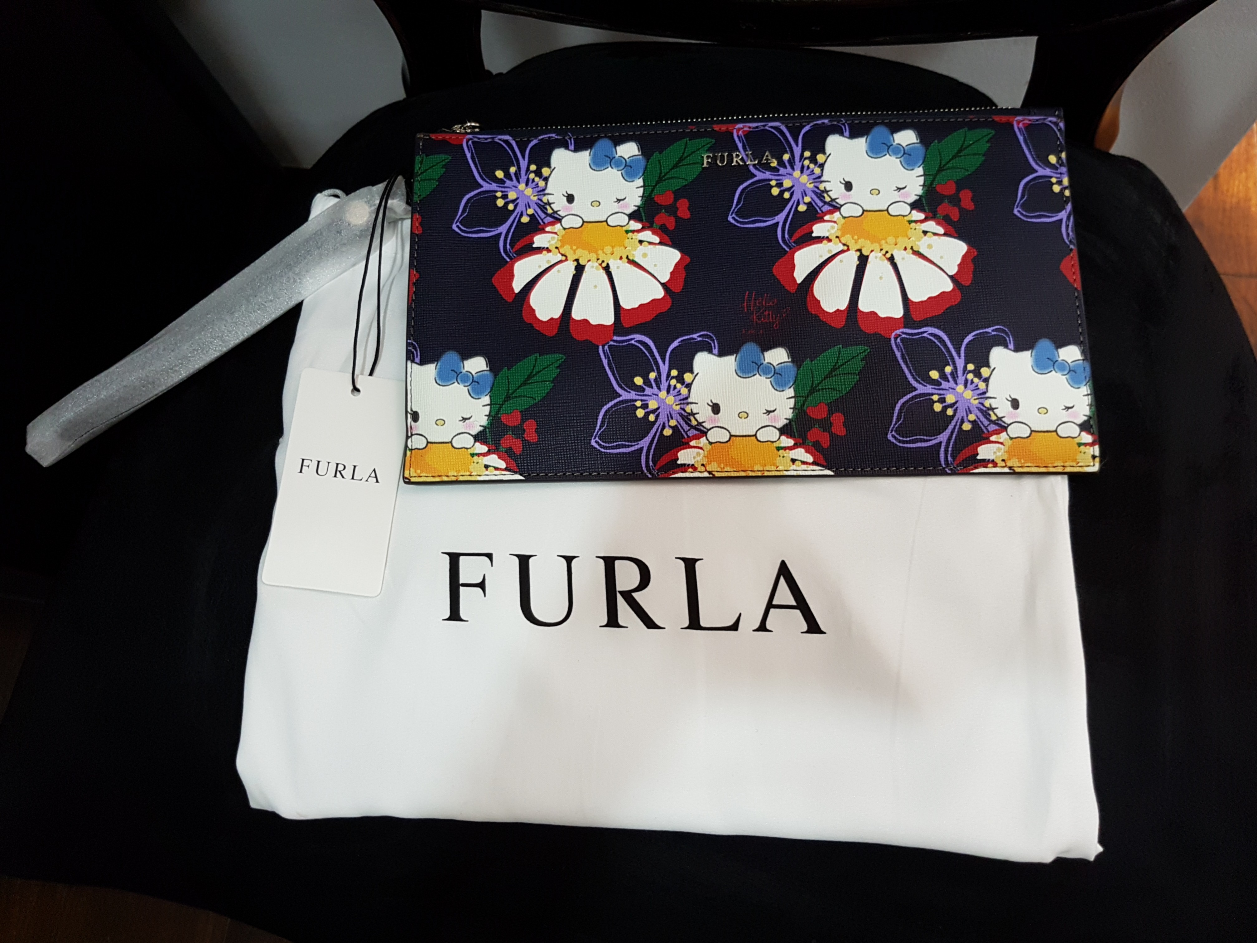 e307688c4 Furla x Hello Kitty clutch, Women's Fashion, Bags & Wallets, Clutches on  Carousell