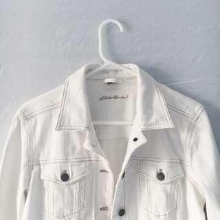 white denim jacket with gold stitching