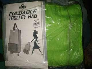 Foldable trolley bag colored green
