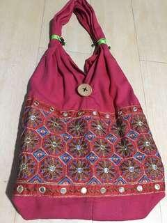 Red embroidered shoulder bag. Made in India.