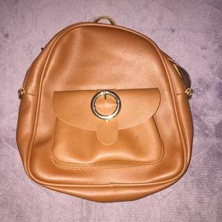 2 way brown leather backpack