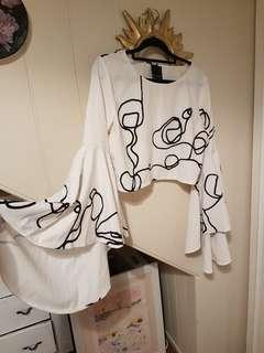 Backstage scribble flare sleeve top