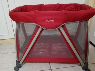Nuna Sena Mini crib with bassinet, mattress, and bag