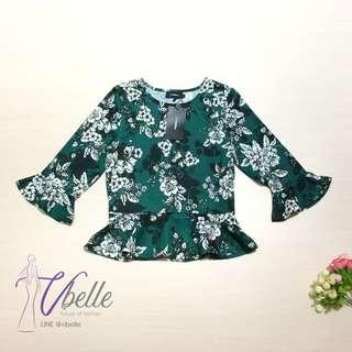 Green flowy bell sleeve top