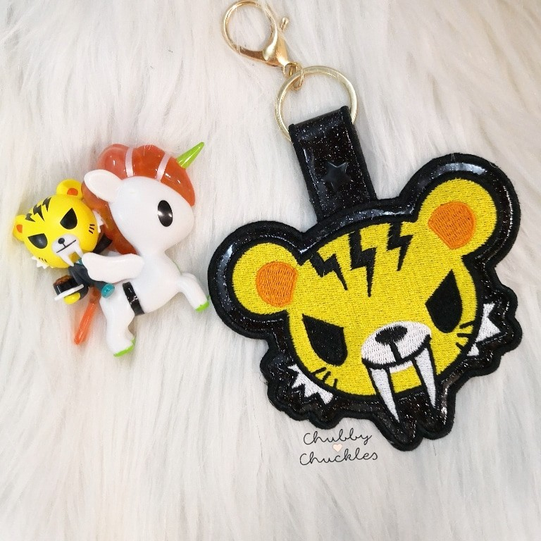 on sale 3e6f1 b4114 Keychain bag tag tokidoki tiger salary man