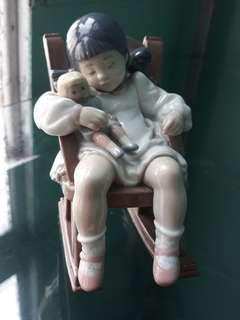 Lladro - child sleeping on rocking chair