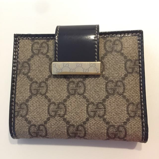 4e0b7434fe58 Authentic Gucci canvas french flap wallet