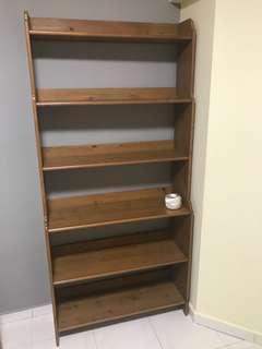 Brown IKEA book shelf