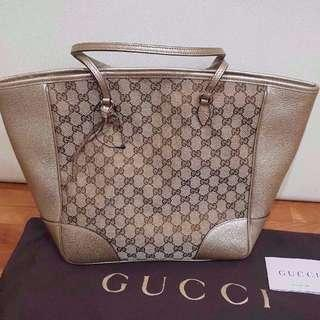 NEW Gucci Women's Signature Monogram Leather Tote Bag (Gold and Beige)
