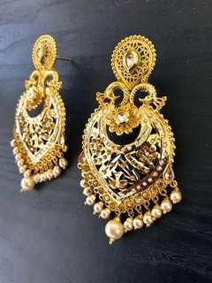 Gorgeous golden peacock earrings