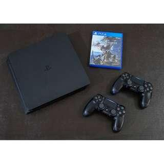 Sony PS4 Complete with Warranty and Games
