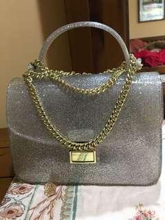 Glittered jelly bag with gold chain sling