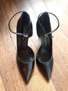 Black high heeled shoes with strap