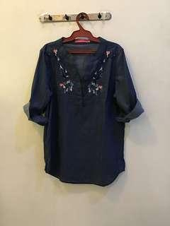 Top with embroidered flowers