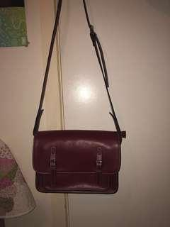 Maroon satchel with strap