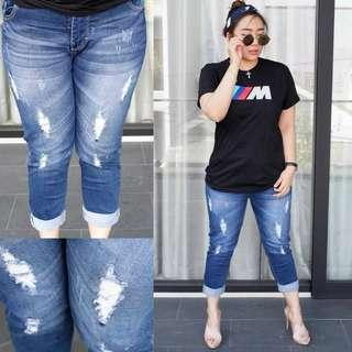 7/9 ripped jeans