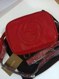 Red Gucci side bags
