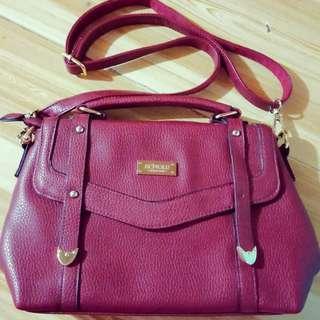 How.R.U red sling bag