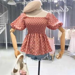 Short sleeve pink with white polka dot pleated blouse