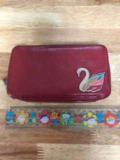 dompet fossil swan