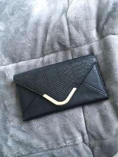 Black envelope snake purse
