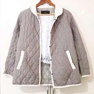 Grayish outerwear