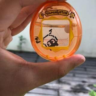 Tamagotchi water keychain orange