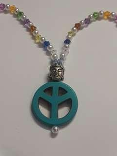 Peace sign with Buddha bead necklace