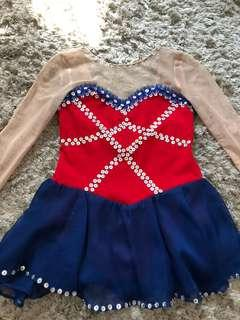 Blue and red beaded figure skating costume