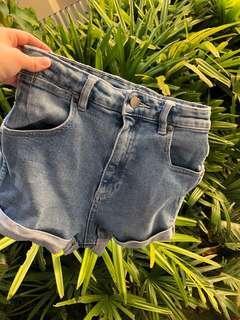 High-waisted blue denim Wrangler shorts.