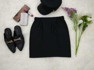 Glossy black mini skirt
