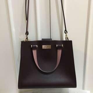 Kate Spade burgundy two tone top handle bag with sling crossbody strap