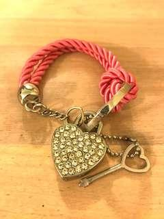 Pink bracelet with heart charm