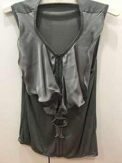 Moss green sleeveless top with zipper and ruffle detail