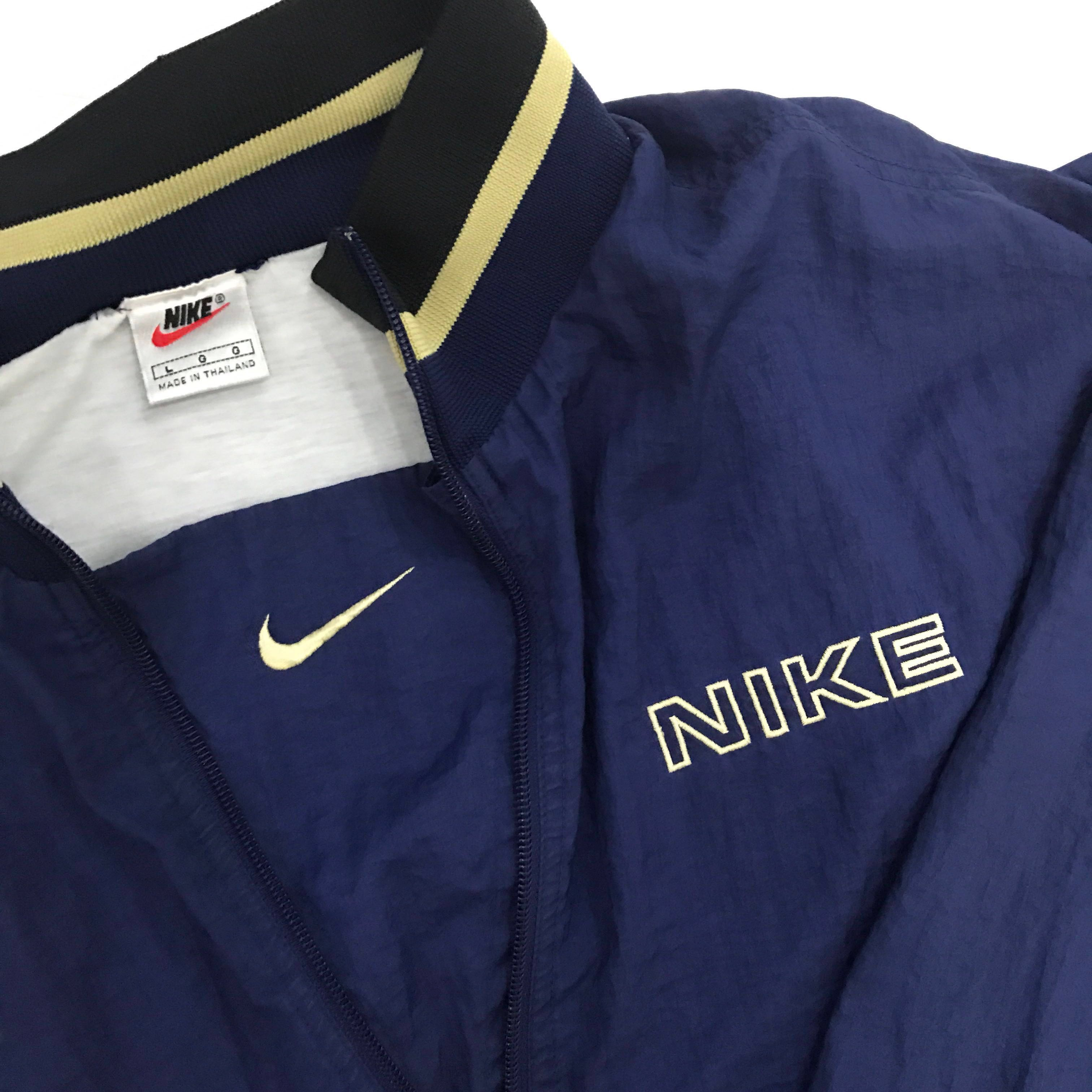 16280a5a vintage nike half zip windbreaker, Men's Fashion, Clothes, Outerwear on  Carousell