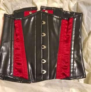 Steel boned corset. Red satin and matte black pvc. Goth