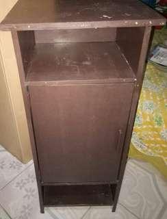 Corner telephone cabinet