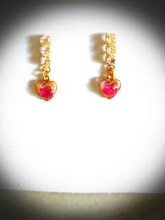 20K gold earrings.