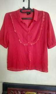Kemeja ( blouse ) wanita .