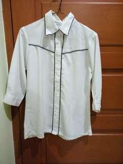 Kemeja putih or white shirt