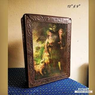 1960-70s Large Biscuits Tin with motif of Old English or Victorian couples and dog. The top looks ok and it has rust on the underside & has two holes size 10 to 20 cents. Great as Film-prop or Display. $10 offer! whatsapp 96337309.