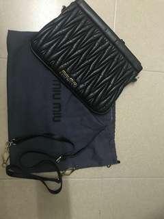 Miumiu clutch with sling