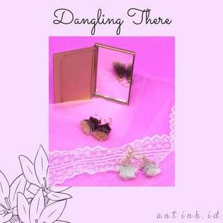 Dangling there- earrings